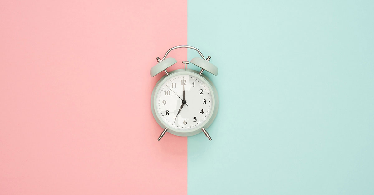 Image of an alarm clock with bicolored background