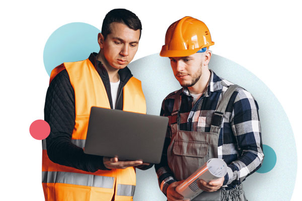 Two working men at a laptop