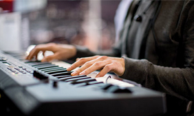 close-up of a Yamaha piano keyboard being played