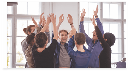 A group of office colleagues celebrating raising their hands